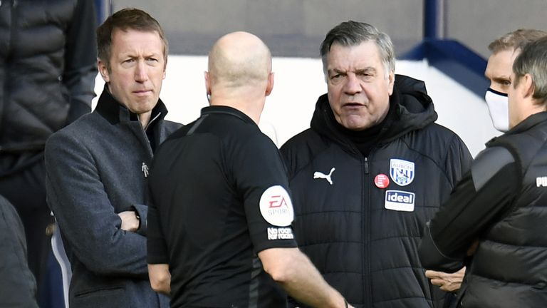 Referee Lee Mason speaks to both managers following confusion over Brighton's disallowed goal