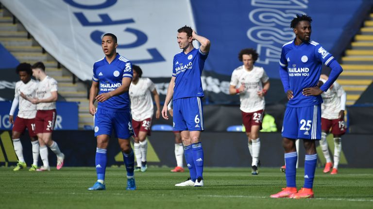 Leicester players look dejected after Arsenal's third - PA