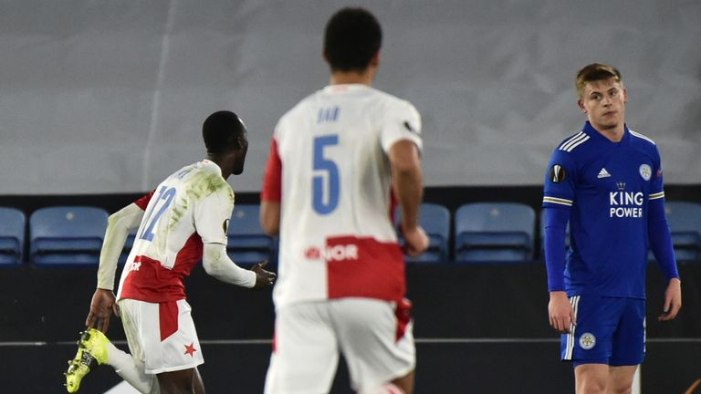 Slavia's Abdallah Sima, second left, celebrates after scoring his side's second goal during the Europa League round of 32 soccer match between Leicester City and Slavia Prague at the King Power Stadium in Leicester, England, Thursday, Feb 25, 2021. (AP Photo/Rui Vieira)