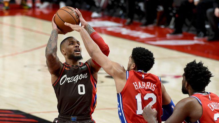 Portland Trail Blazers guard Damian Lillard hits a shot over Philadelphia 76ers forward Tobias Harris