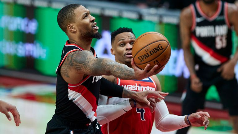 Portland Trail Blazers guard Damian Lillard shoots next to Washington Wizards guard Russell Westbrook