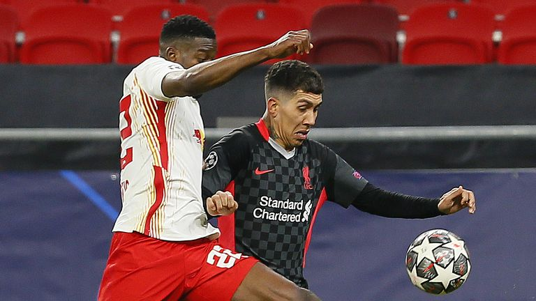 Liverpool's Roberto Firminho takes on RB Leipzig's Nordi Mukiele in Tuesday's last 16 tie