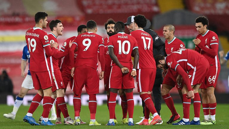 Liverpool manager Jurgen Klopp speaks to his players before the start of the second half during the Premier League match at Anfield, Liverpool. Picture date: Saturday February 20, 2021.