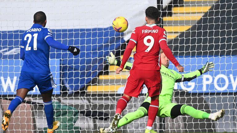 Kasper Schmeichel saves from Roberto Firmino during the first half