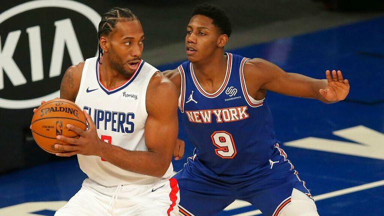 AP - Los Angeles Clippers small forward Kawhi Leonard (2) controls the ball against New York Knicks shooting guard RJ Barrett (9)