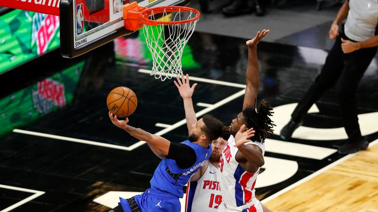 Orlando Magic guard Michael Carter-Williams gots to the basket as Detroit Pistons guard Svi Mykhailiuk and Detroit Pistons center Isaiah Stewart