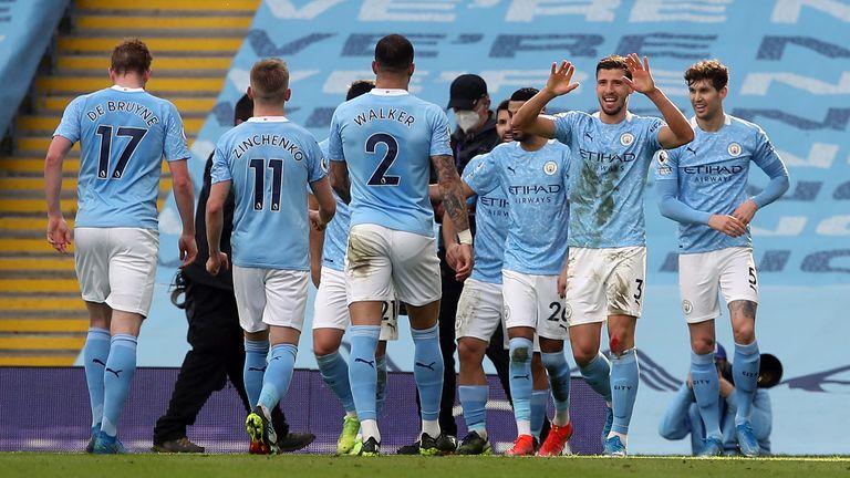Ruben Dias celebrates with team-mates during City's 2-1 win over West Ham