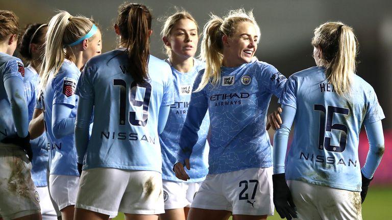 Manchester City's Lauren Hemp (right) celebrates scoring their second goal against Manchester United