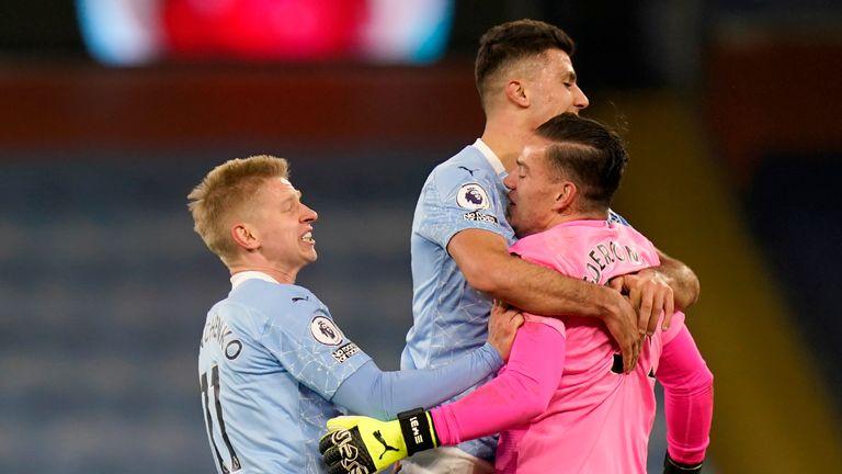 Manchester City's Oleksandr Zinchenko, Rodrigo  and Ederson celebrate their third goal against Spurs