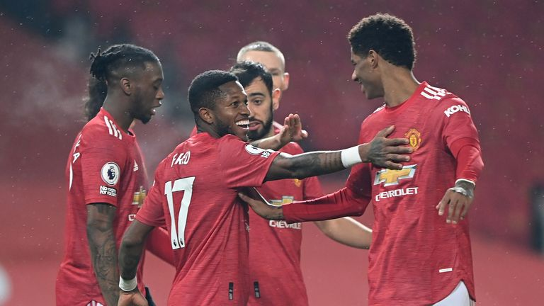 Manchester United's Fred and Marcus Rashford celebrate after their third goal is scored against Southampton