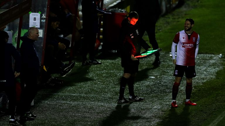 Matt Jarvis of Woking FC awaits for the assistant referee makes changes to the board to enter the field as a substitute during the Vanarama National League match between Woking and Dagenham and Redbridge at Kingfield Stadium on October 13, 2020 in Woking, England.