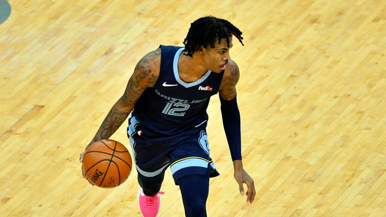 AP - Memphis Grizzlies guard Ja Morant handles the ball