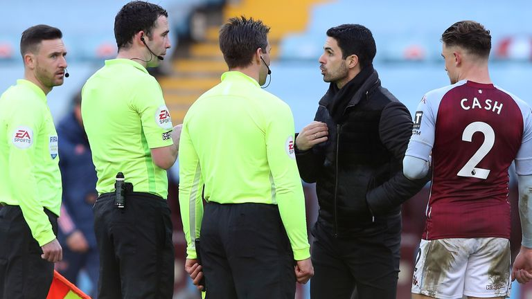 Arsenal's Mikel Arteta speaks with officials after his side's 1-0 defeat at Aston Villa