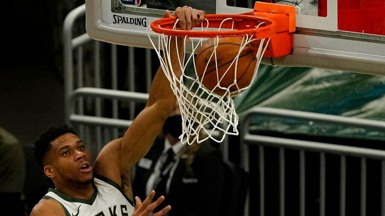 AP - Milwaukee Bucks' Giannis Antetokounmpo dunks during the first half
