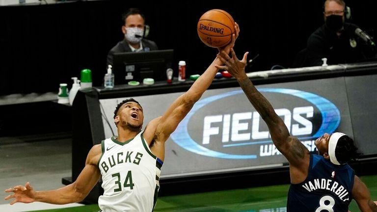 AP - Milwaukee Bucks' Giannis Antetokounmpo and Minnesota Timberwolves' Jarred Vanderbilt go after a rebound