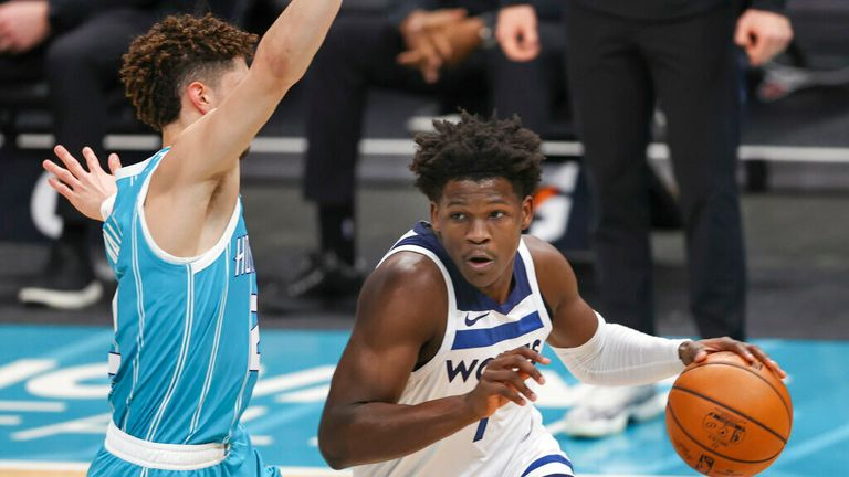 AP - Minnesota Timberwolves forward Anthony Edwards, right, drives past Charlotte Hornets guard LaMelo Ball