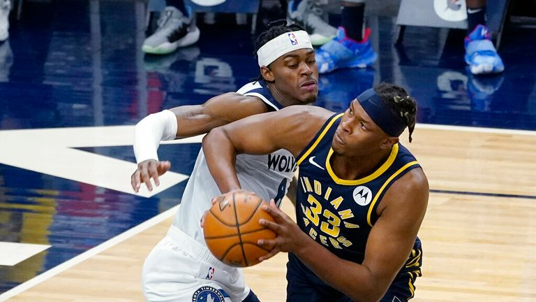 AP - Indiana Pacers' Myles Turner (33) eyes the basket as he works around Minnesota Timberwolves' Jaylen Nowell