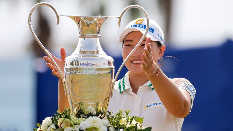 Mirim Lee receives the trophy after winning the LPGA's ANA Inspiration at Mission Hills