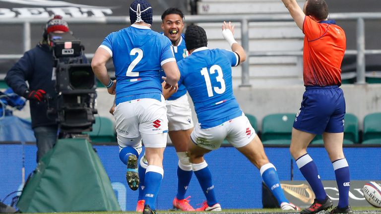 Monty Ioane of Italy (center) celebrates after scoring the opening try in the Six Nations tie against England