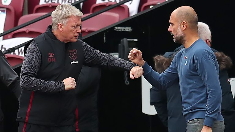 West Ham manager David Moyes (left) with Manchester City manager Pep Guardiola
