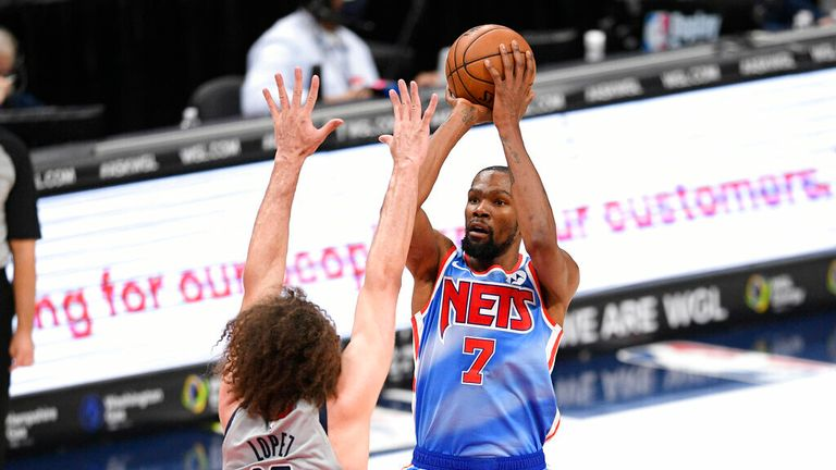 AP - Brooklyn Nets forward Kevin Durant (7) shoots against Washington Wizards center Robin Lopez (15)