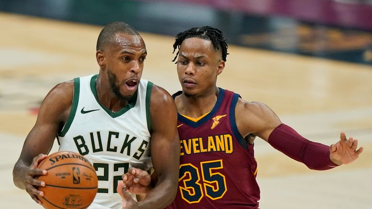 Milwaukee Bucks' Khris Middleton (22) drives against Cleveland Cavaliers' Isaac Okoro (35) in the first half of an NBA basketball game, Friday, Feb. 5, 2021, in Cleveland. (AP Photo/Tony Dejak)