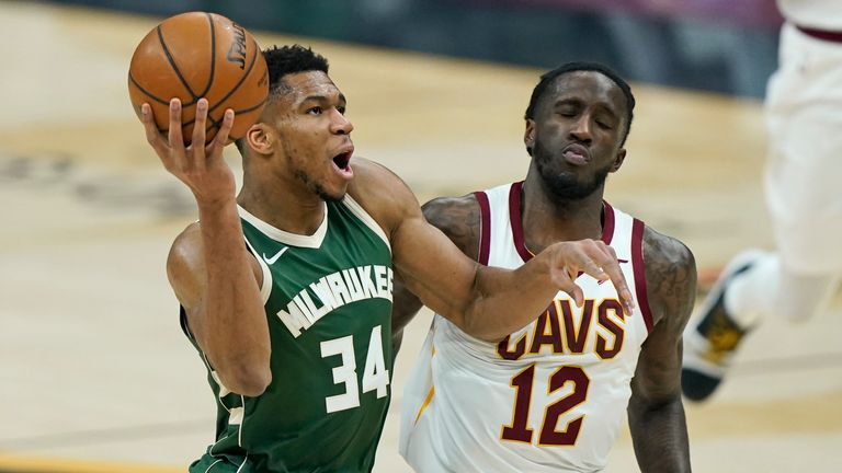 Milwaukee Bucks' Giannis Antetokounmpo (34) drives to the basket against Cleveland Cavaliers' Taurean Prince (12) in the first half of an NBA basketball game, Saturday, Feb. 6, 2021, in Cleveland. (AP Photo/Tony Dejak)