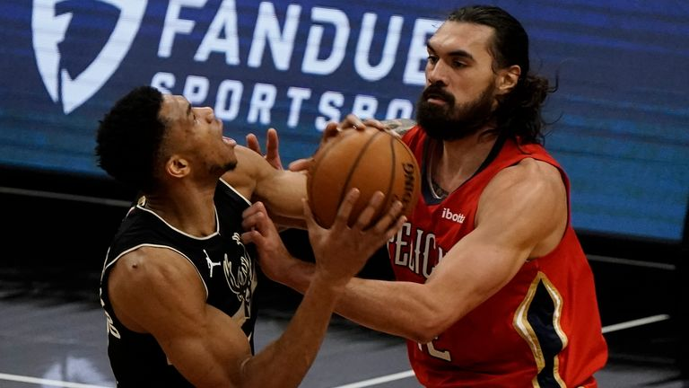 Milwaukee Bucks' Giannis Antetokounmpo tries to drive past New Orleans Pelicans' Steven Adams during the first half of an NBA basketball game Thursday, Feb. 25, 2021, in Milwaukee.