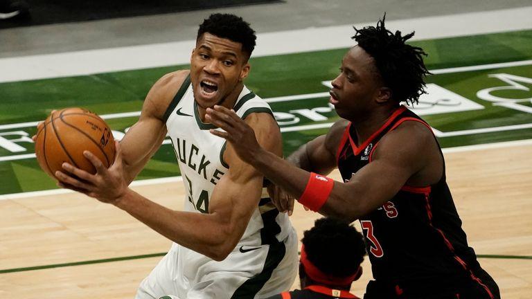 Milwaukee Bucks' Giannis Antetokounmpo tries to drive on Toronto Raptors' OG Anunoby during the second half of an NBA basketball game Tuesday, Feb. 16, 2021, in Milwaukee.