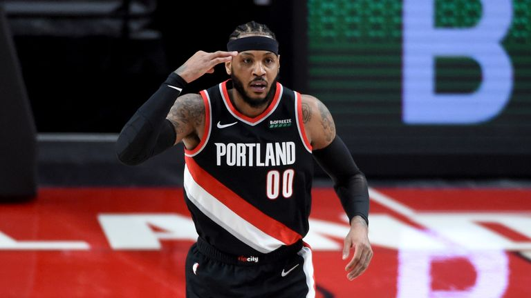 Portland Trail Blazers forward Carmelo Anthony reacts after hitting a three point shot during the first half of an NBA basketball game against the Orlando Magic in Portland, Ore., Tuesday, Feb. 9, 2021. (AP Photo/Steve Dykes)