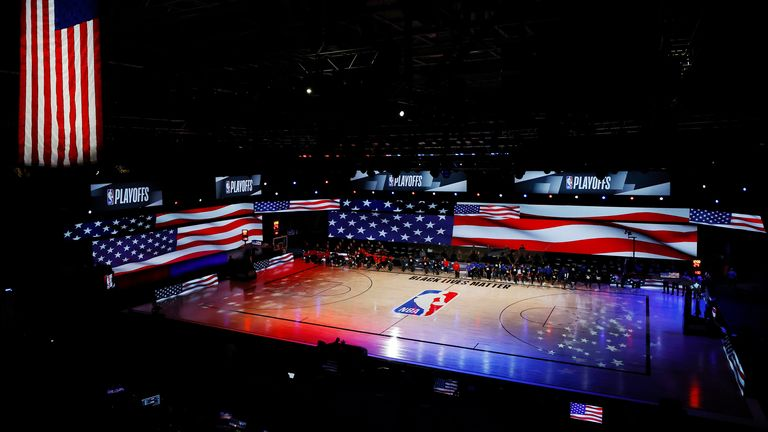 Players take a knee during the national anthem before a game between the LA Clippers and the Dallas Mavericks in Game One of the Western Conference First Round during the 2020 NBA Playoffs
