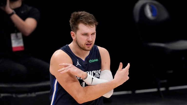 Dallas Mavericks' Luka Doncic celebrates a basket against the Golden State Warriors in an NBA basketball game in Dallas, Saturday, Feb. 6, 2021. (AP Photo/Tony Gutierrez)