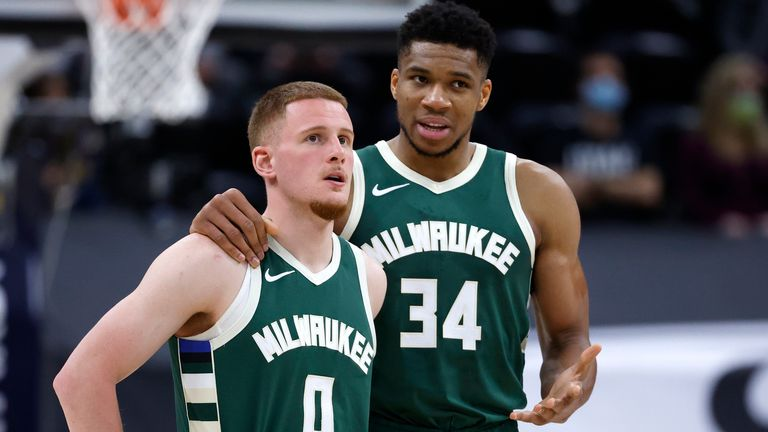 Giannis Antetokounmpo shares some advice with Done DiVincenzo during a Milwaukee Bucks game