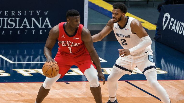 New Orleans Pelicans forward Zion Williamson (1) is defended by Memphis Grizzlies forward Xavier Tillman (2) in the third quarter of an NBA basketball game in New Orleans, Saturday, Feb. 6, 2021. (AP Photo/Derick Hingle)