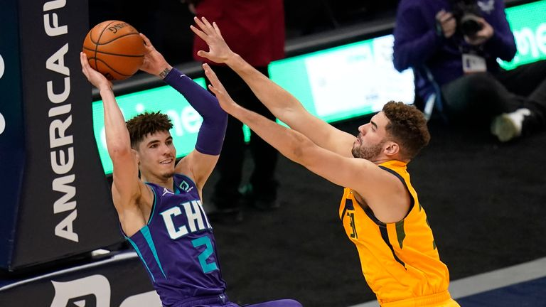 Utah Jazz forward Georges Niang, right, guards Charlotte Hornets guard LaMelo Ball (2) in the second half during an NBA basketball game Monday, Feb. 22, 2021, in Salt Lake City.