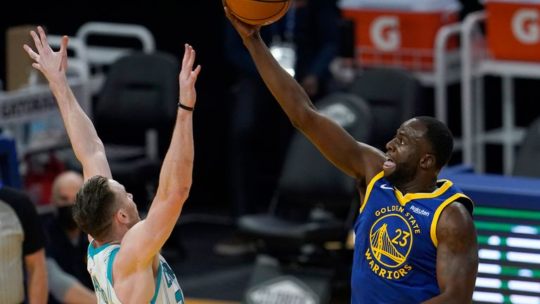 Golden State Warriors forward Draymond Green (23) shoots against Charlotte Hornets forward Gordon Hayward during the first half of an NBA basketball game in San Francisco, Friday, Feb. 26, 2021. (AP Photo/Jeff Chiu)