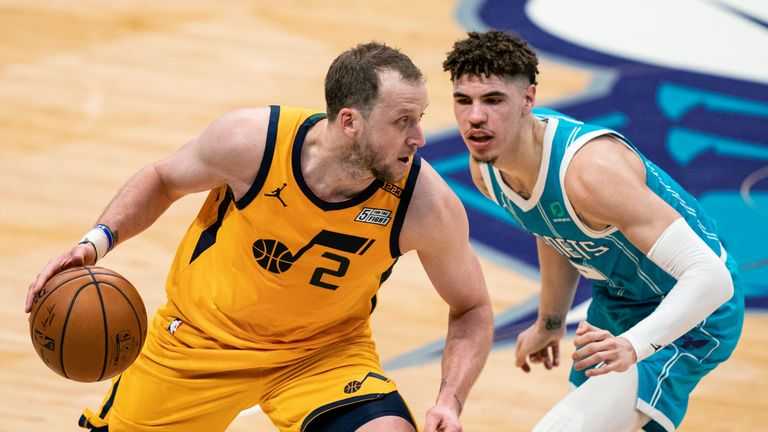 Utah Jazz forward Joe Ingles (2) brings the ball up whiled guarded by Charlotte Hornets guard LaMelo Ball (2) during the second half of an NBA basketball game in Charlotte, N.C., Friday, Feb. 5, 2021. (AP Photo/Jacob Kupferman)