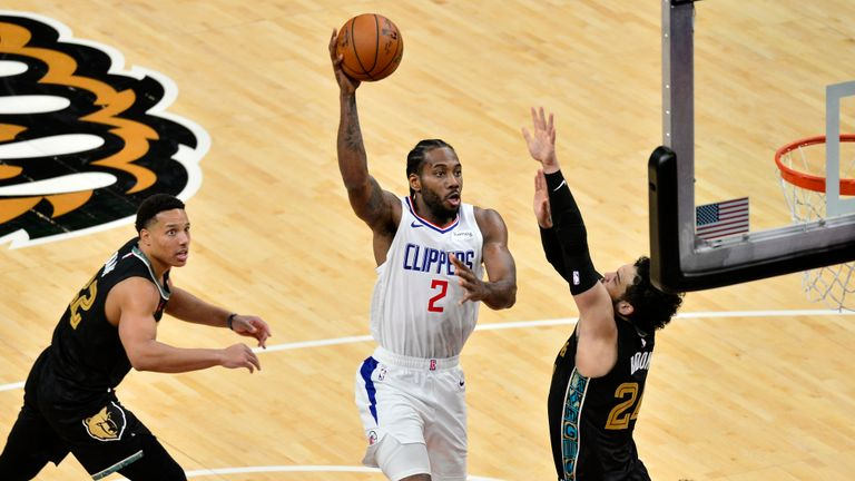 Los Angeles Clippers forward Kawhi Leonard (2) shoots between Memphis Grizzlies guards Dillon Brooks (24) and Desmond Bane (22) during the second half of an NBA basketball game Friday, Feb. 26, 2021, in Memphis, Tenn. (AP Photo/Brandon Dill)
