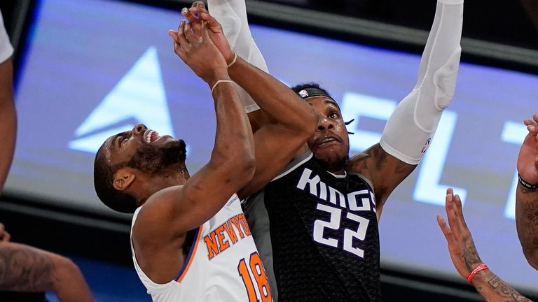 New York Knicks guard Alec Burks (18) is fouled by Sacramento Kings center Richaun Holmes (22) during the first half of an NBA basketball game Thursday, Feb. 25, 2021, in New York.