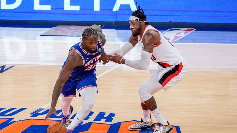 New York Knicks forward Julius Randle (30) drives against Portland Trail Blazers forward Robert Covington (23) during the second half of an NBA basketball game, Saturday, Feb. 6, 2021, in New York. The Knicks won 110-99. (AP Photo/Mary Altaffer, Pool)