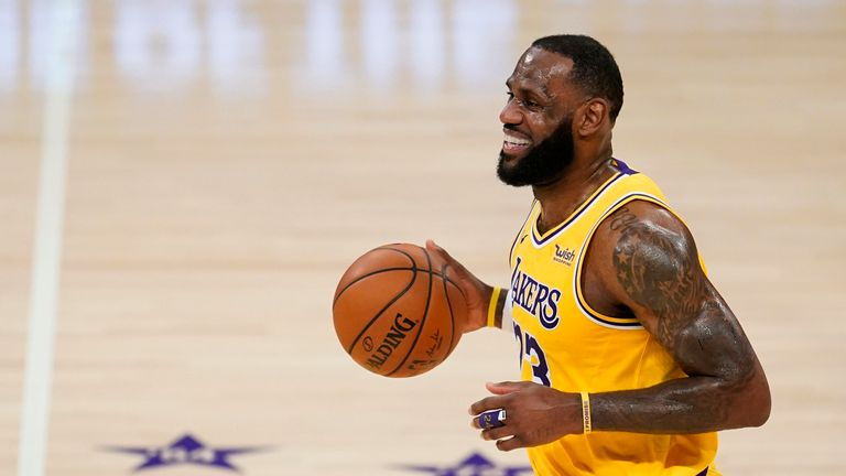 Los Angeles Lakers forward LeBron James smiles as he dribbles the ball during the first half of the team's NBA basketball game against the Detroit Pistons on Saturday, Feb. 6, 2021, in Los Angeles. (AP Photo/Marcio Jose Sanchez)