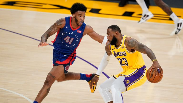 Los Angeles Lakers forward LeBron James (23) is defended by Detroit Pistons forward Saddiq Bey (41) during the first half of an NBA basketball game Saturday, Feb. 6, 2021, in Los Angeles. (AP Photo/Marcio Jose Sanchez)
