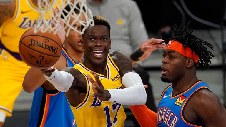 Los Angeles Lakers guard Dennis Schroder, left, shoots as Oklahoma City Thunder forward Luguentz Dort defends during the first half of an NBA basketball game Monday, Feb. 8, 2021, in Los Angeles. (AP Photo/Mark J. Terrill)