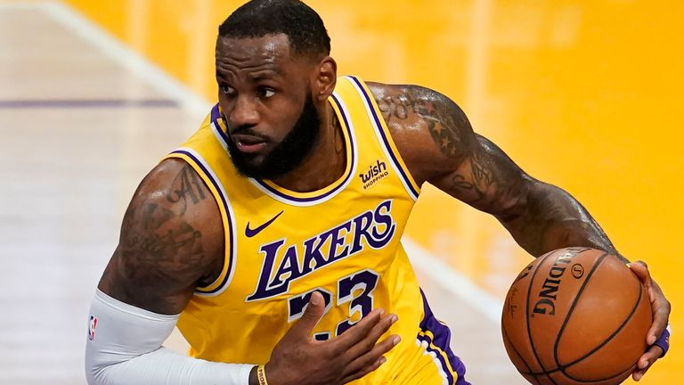 Los Angeles Lakers forward LeBron James dribbles against the Detroit Pistons during an NBA basketball game Saturday, Feb. 6, 2021, in Los Angeles. (AP Photo/Marcio Jose Sanchez)