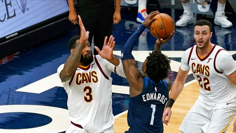 AP - Minnesota Timberwolves' Anthony Edwards (1) shoots over Cleveland Cavaliers' Andre Drummond (3) as Cavaliers' Larry Nance Jr. looks on