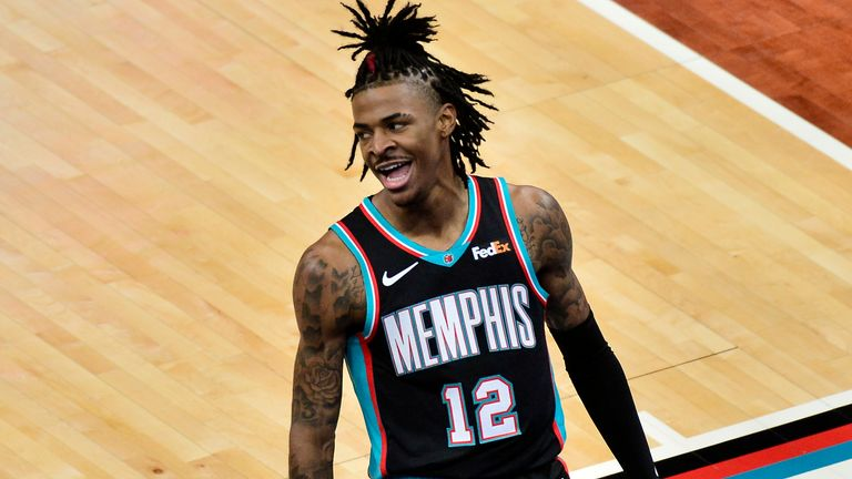 Memphis Grizzlies guard Ja Morant (12) reacts in the first half of an NBA basketball game against the Los Angeles Clippers Thursday, Feb. 25, 2021, in Memphis, Tenn.