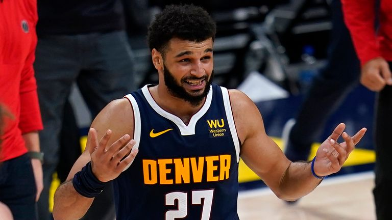 Denver Nuggets guard Jamal Murray reacts to the team's loss to the Washington Wizards in an NBA basketball game Thursday, Feb. 25, 2021, in Denver.
