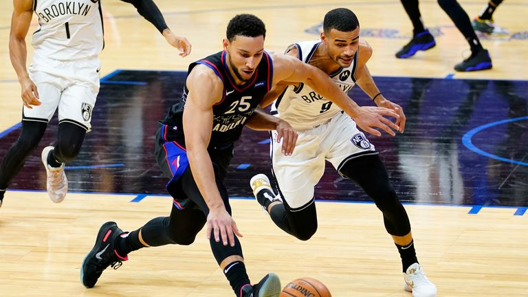 Philadelphia 76ers' Ben Simmons, left, and Brooklyn Nets' Timothe Luwawu-Cabarrot chase down a loose ball during the second half of an NBA basketball game, Saturday, Feb. 6, 2021, in Philadelphia. (AP Photo/Matt Slocum)