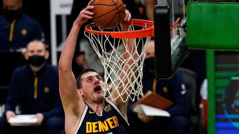 Denver Nuggets center Nikola Jokic (15) slams a dunk against the Boston Celtics during the first half of an NBA basketball game, Tuesday, Feb. 16, 2021, in Boston.