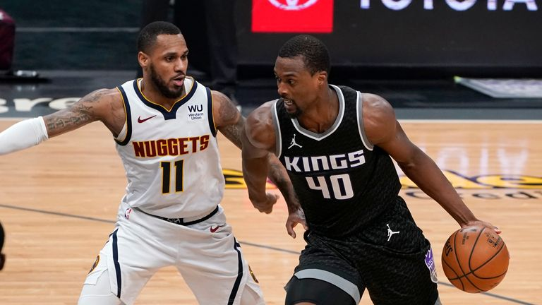 Sacramento Kings forward Harrison Barnes, right, drives against Denver Nuggets guard Monte Morris during the second half of an NBA basketball game in Sacramento, Calif., Saturday, Feb. 6, 2021. The Kings won 119-114. (AP Photo/Rich Pedroncelli)